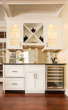 Wet bar with wine and stemware storage. Love that there are refrigerated drawers.