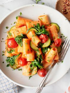 This creamy pasta pomodoro recipe will become your go-to healthy weeknight dinner! It's fresh, easy & satisfying, made with lots of sautéed green veggies, cherry tomatoes, and a lightly creamy vegan tomato sauce. | Love and Lemons #pasta #healthyrecipes #dinnerideas #vegan Pasta Pomodoro Recipe, Marinara Recipe, Rigatoni, Pasta Recipes, Dinner Recipes, Dinner Ideas, Cooking Recipes, Sauteed Vegetables, Creamy Pasta