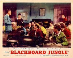 "April 12  This Day In Entertainment  1954 - The song ""Rock Around the Clock"" is released; hits #1 in movie ""Blackboard Jungle""."