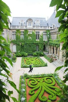 The beautiful parterre of the courtyard of the Carnavalet Museum in the Le Marais, Paris.~ The Secret Gardens of Paris