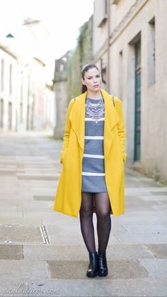 "Yellow coat and Grey dress -  As first seen on blog ""Paula Deiros's Secerts"" here: Yellow coat and Grey dress  She is wearing tights similar here: Black Opaque Tights Richly saturated 50 denier matte opaque tights with signature waistband designed for incomparable comfort."