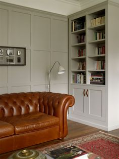 soft mushroom grey colour to walls and to furniture enhances feeling of space alcove lighting ideas