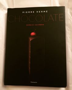 """""""Chocolate"""" By: Pierre Hermé and Sergio Coimbra This is a chocoholics dream come true! This book is filled with fabulous, mouthwatering photographs that are simply stunning to the eyes!…"""