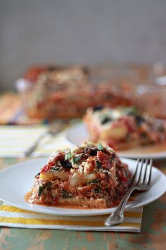 Layers of polenta, spinach, and feta cheese put a Greek twist on #lasagna!