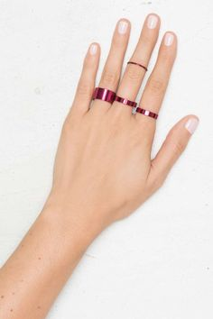 Think hot pink! This ring set features 4 rings in metallic pink that can be worn stacked or separate.