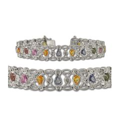 Diamond and Multi Gemstone Bracelet with Milgrain Work 4.10 ct tw in 14K White Gold. 0.85 ct tw Round Diamond & 3.25 ct tw Pear Shape Multi Gemstone Bracelet with Milgrain Work in 14K White Gold. 57 Round Diamond of 2mm each & 19 Pear Shape Multi Gemstone of 3mm x 4mm each set using Prong & Bezel Setting. Gemstones may have been Treated to Improve their Appearance or Durability & may Require Special Care. The Natural Properties & Composition of Mined Gemstones define the Unique Beauty of...