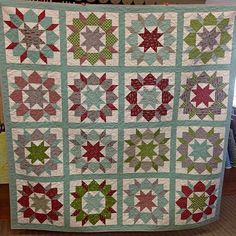 New store sample! The pattern is Swoon Sixteen by #thimbleblossoms and uses the Holly's Tree Farm fabric line by Sweet Water for #modafabrics! Kits are available in store and online! #olivejuicequilts