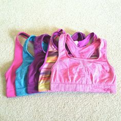 C9 by Champion Sports Bra Bundle XL 2XL This pre-made bundle includes 5 sports bras. The 3 bras in the third photo are an XL and the 2 bras in the fourth photo are a 2XL. They are in different conditions ranging from very good pre-owned condition to fair condition. None have any holes or tears. Champion Intimates & Sleepwear Bras