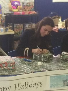 """""""The Duchess of Cambridge helps volunteers wrap donated gifts at the Northside Center in Harlem. #RoyalVisitUSA"""""""