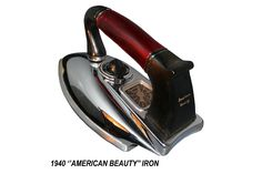 """Streamlined """"American Beauty"""" iron with red lucite and black bakelite handle on the chrome iron. Manufactured by the American Electrical Heater Co.: Detroit Mich., (1940)"""