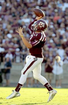 Johnny Manziel of the Texas A M Aggies completes a pass agains the Southern  Methodist Mustangs in the first half on September 2013 at Kyle Field in  College ... 4f91d3340