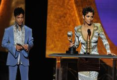 He had on a nice, (edit-color of suit) light blue suit and Prince presented the award to Halle Berry. Description from prince.org. I searched for this on bing.com/images