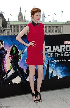 Toned to perfection: Karen Gillan showcased her trim pins in a short red mini dress which was teamed with a pair of eye-catching black heels