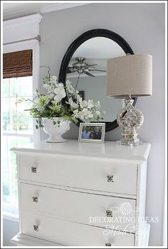 How To Accessorize Your Home Like A Pro (great tips and lots of examples!). Bedroom white dressee with lamp and mirror