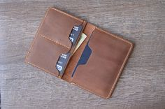 This listing is for a PERSONALIZED leather passport wallet.  When youre travelling, your passport is your most valuable asset so make sure to keep it protected. Great value and quality rolled into a perfect blend of awesomeness.  Buy your passport wallet today!  ✦✦✦ Yes, it will hold 2 passports.   {{{ PRODUCT FEATURES }}}   ♦ 100% Top Grain Leather ♦ Hand-stitching ♦ Distressed Leather, gets better and better with age (and it forms a patina very quickly) ♦ 2 large inner pockets ♦ 4 credit…