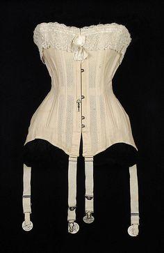 Corset Date: ca. 1906 Culture: American Medium: Cotton, bone, metal, elastic Accession Number: 2009.300.6654a, b