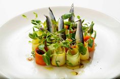 Pickled vegetables with sunflower, pickled white anchovies and herbs with a dressing on roasted sunflower seeds.