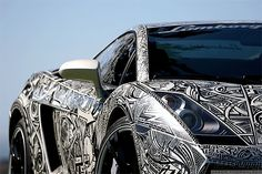 this lamborghini was decorated with sharpie markers - chris has the motorcycle helmet designed by the same artist and the design looks like the car