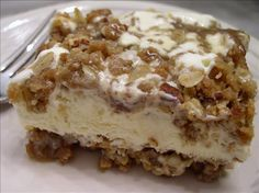 Caramel Pecan Ice Cream Dessert from Food.com:   This lucious high calorie ice cream dessert is sooo good you may want to pass on dinner and get right to the dessert.  It is easy to make and disgustingly yummy. This recipe is 2 part so I have broken it down in ingredients and directions.