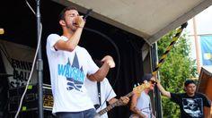 Joe B of Transit wearing a War Games shirt during their set at Warped!