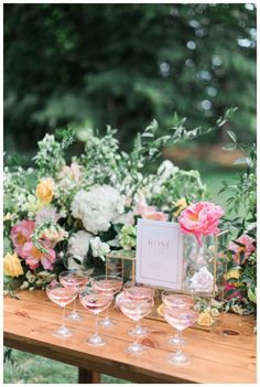"Modern Garden inspired wedding with bright colors in yellow, pinks, greens and whites. Learn how to create a signature ""rose bar"" at your wedding, featuring these vintage champagne coupes."