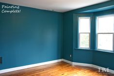 Almost exactly the look we are going for--teal blue walls, light wood flooring, white ceilings and baseboards :)
