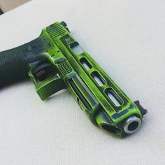 Zombie Green Glock 34 Speed up and simplify the pistol loading process with the RAE Industries Magazine Loader. http://www.amazon.com/shops/raeind