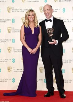 BFTA Hitting the big time: Reese Witherspoon poses with actor JK Simmons in the press room, who won Best Supporting Actor for his role in Whiplash