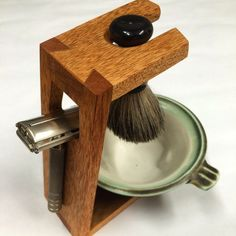 Handcrafted wood safety razor stand. Holds a safety razor, lather brush and has room for a lather bowl. Made with fine attention to detail and lots