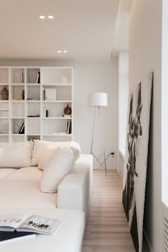 Recessed lighting makes it feel as though it is always sunny inside the room, reflecting softly off so many white surfaces and really opening up the space.