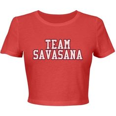 Team Savasana   Show your team spirit! Cute crop top, is vibrant coral. Sloth in lotus logo on back. Look for more in our Team Savasana Collection.   Samira