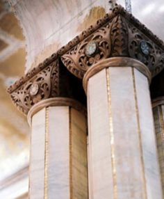 Marble, gold leaf striping on the columns in the Criterion Restaurant in London.