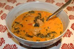 Creamy Tomato, Sausage, and Kale Soup.  Try coconut milk in place of cream.
