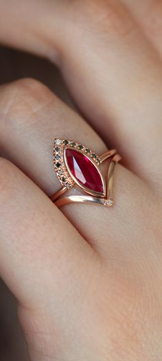 A gorgeous ring set with a marquise ruby engagement ring with black diamonds and a matching wedding Ruby Wedding Rings, Classic Wedding Rings, Gold Diamond Wedding Band, Rose Gold Engagement Ring, Jewelry Design Earrings, Gold Earrings Designs, Gold Jewellery Design, Gold Ring Designs, Gold Jewelry Simple