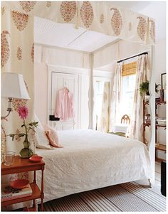 bed is home made from white plywood--love the pink and brown and big paisley--House Beautiful