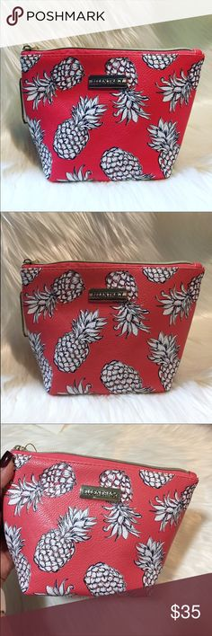 """Pineapple Cosmetic Coral Makeup Bag Cute 💯 % PVC bag, coral (not orange) with white pineapples and gold hardware, brand new with tags. Size 8""""x6"""", perfect for make up and accessories, I even use these bags in my diaper bag to hold baby things like pacifiers, little hairbrush, hair ties small toys. It really can be used for anything!! Did I mention it has pineapples all over it?? 🍍🍍🍍 Ellen Tracy Bags Cosmetic Bags & Cases"""
