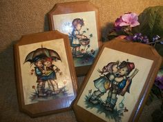 Set of Three Mounted Prints, Vintage Wall Hangings, Home Decor Plaques dated late 1960's - very early 1970's using prints signed 'Evans'  Prints depict mid-century German children Artwork created in the style of Hummel Bright colors and soft lines ...