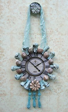 Vintage Clock Face, OOAK, French Clock Decorative Ornament, Shabby Beach Cottage Chic, Chippy Aqua Framed Shell Clock,. $20.00, via Etsy.