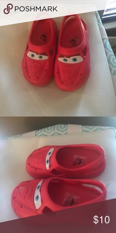 Cars crockies These cars crocs style little shoes are lightning McQueen, brand new never worn,have the little fake wheels and everything hubs bought little dude the wrong size.  I'm not 100% sure they are Disney bit they have the cars logo  inside Size is 9/10 🚭🚫🐱🚫🐶🏡 Disney Shoes Sandals & Flip Flops