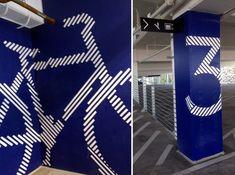 RSM Design Environmental Experiential Architectural Graphic Design Project Portfolio Miami Design District Miami FL Retail And Entertainment Palm Court Garage Level Identity Painted Wall Mural Bike Pedestrian Stairs Elevator Vehicular Wayfinding
