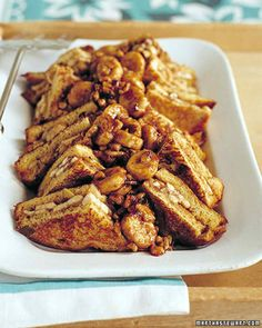 For a heartier take on banana-nut bread, spread a mixture of bananas, brown sugar, and walnuts between slices of golden brioche before battering and frying. Line up the resulting French toast sandwiches on a large platter, and top with the remaining warm banana mixture before serving.
