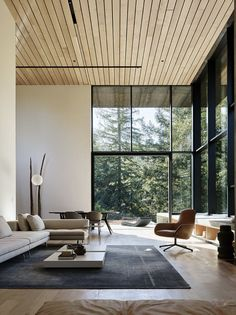 Nature Drove the Design of This Sculptural, Cor-Ten Steel House in Northern California - Photo 4 of 13 - The living room features a sectional sofa and leather chair by Zanotta, coffee tables by Porro, a Kymo rug, and a floor lamp from Flos.