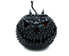 1.carve pumpkin 2.stick tacks  or stud or upholstery pins in pumpkin 3. spray paint black .