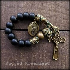 Soldier's one decade Paracord Rosary - Versatile styling in military colors - attaches to almost anything. Benedict Crucifix and St. Paracord Rosary, 550 Paracord, Rosary Beads, Prayer Beads, Molle Gear, Rosary Catholic, Split Ring, Crucifix, Crosses