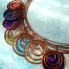 Washi paper and wire necklace by PaperDemomJewelry. ??Wire, paper & resin possibility?