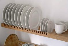 Steal This Look: A Scandi-Style Kitchen in a Canadian Cabin A custom shelf by Peter Henderson Furniture features slots for storing plates. Go to Peter Henderson for more information. See more in our post 10 Easy Pieces: Wall-Mounted Plate Racks. Plate Racks In Kitchen, Kitchen Wall Shelves, Kitchen Storage, Kitchen Cabinets, Diy Plate Rack, Wooden Plate Rack, Plate Rack Wall, Kitchen Drying Rack, Wooden Dish Rack