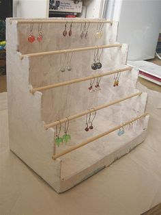 Earring Display: Take a sturdy box, cut the sides like a staircase and paper maché. The dowels are removable so the earrings can slide off (they can also slip on over the dowel)