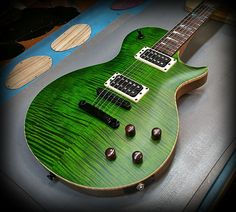 CS6 deep moss green over flamed maple top in satin finish with Kiesel lithium pick ups! — at Kiesel Guitars Carvin Guitars.