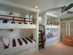 These four bunk beds actually sleep six thanks to two trundle beds that pull out from the lower beds. The coastal room is very kid-friendly and is adjacent to an equally kid-friendly Jack-and-Jill bathroom. Four Bunk Beds, Bunk Bed Rooms, Double Bunk Beds, Bunk Beds Built In, Modern Bunk Beds, Bedrooms, Trundle Beds, Home Bedroom, Kids Bedroom