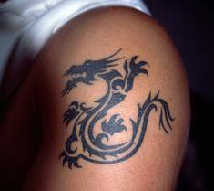 Black chinese dragon tattoo on shoulder